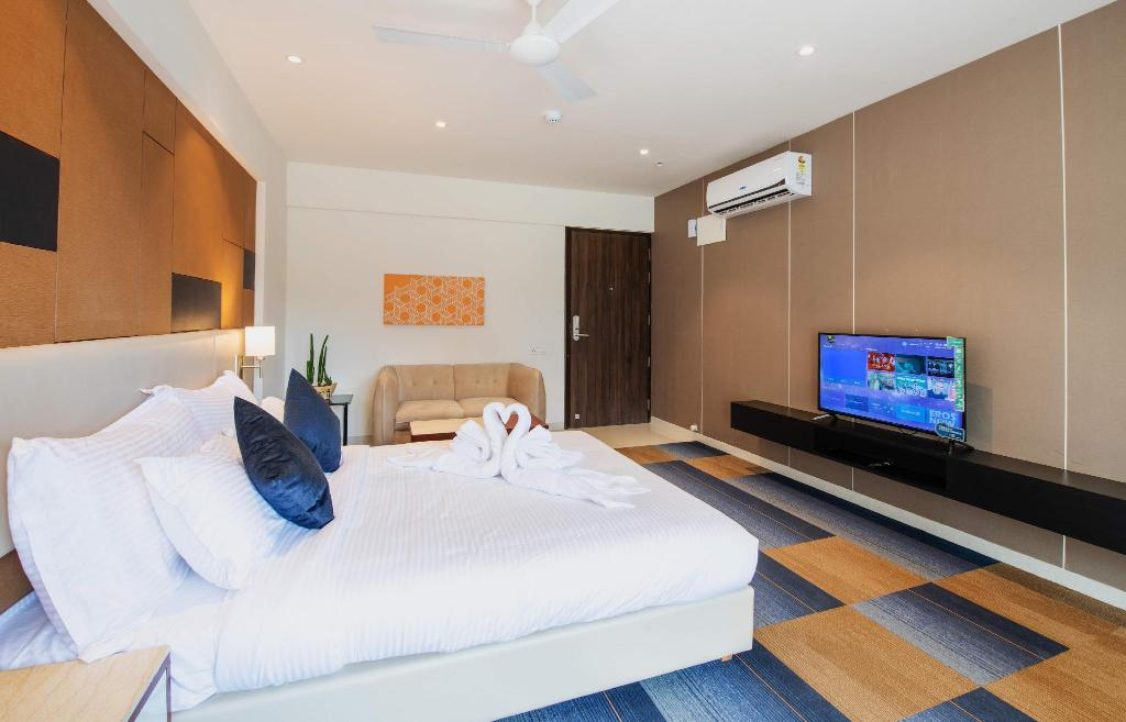 Deluxe Room with Balcony - Bedroom I suite Hotel Kharadi Pune