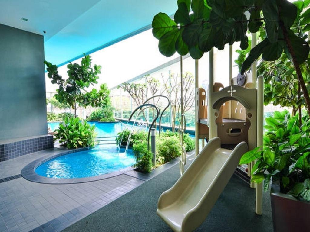 Taman bermain Stylish Casa Residency Service Apartment