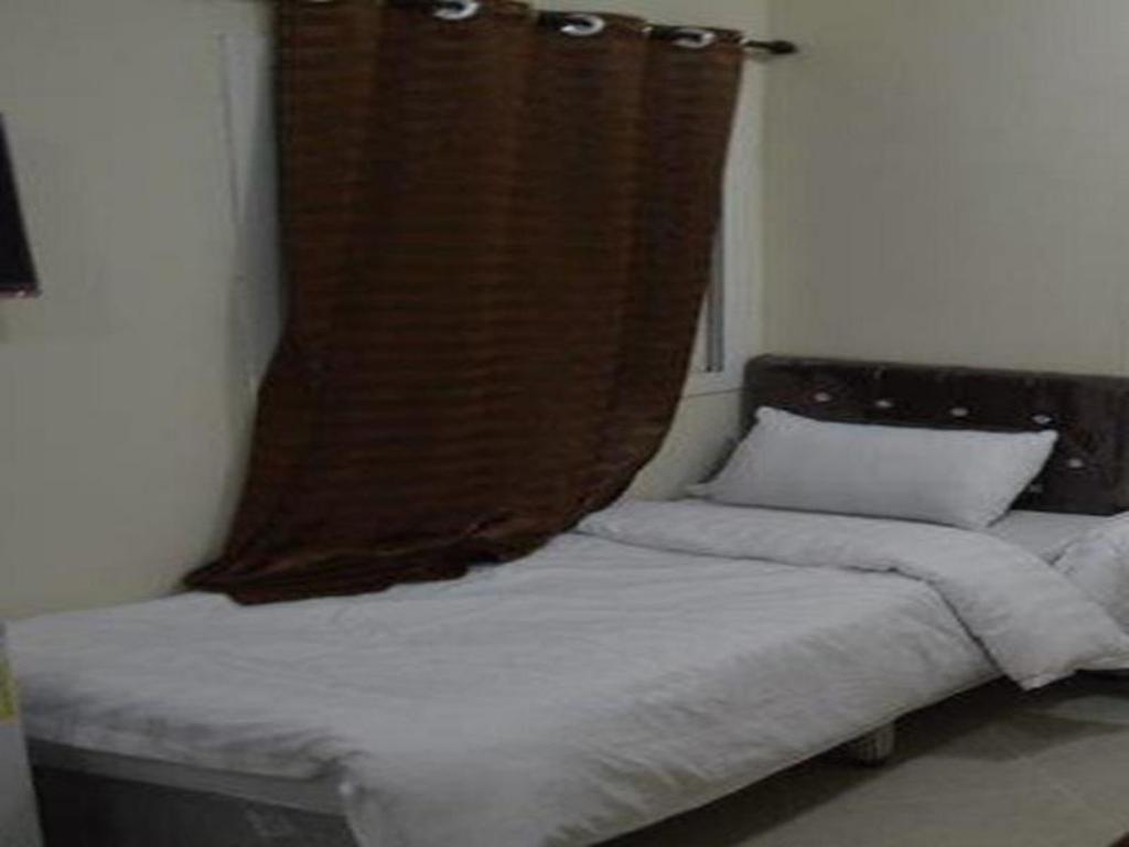 Single Room - Bed Manazil Al Rafidain Hotel