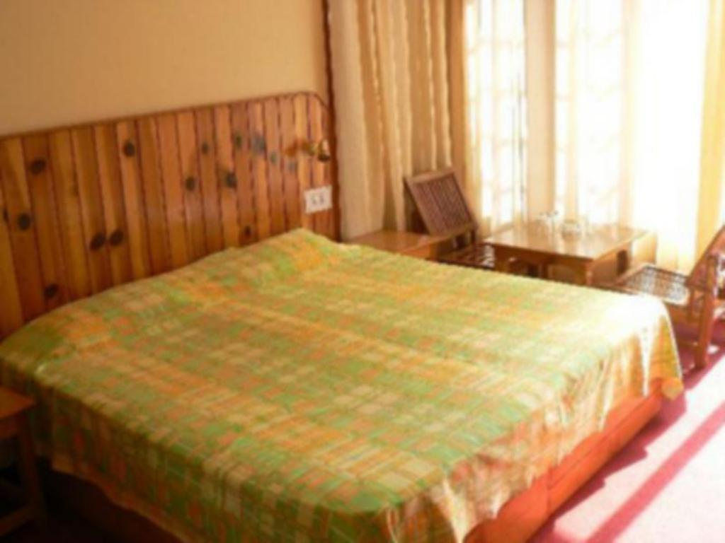Deluxe Room - Bed Purnima Guest House Kasol