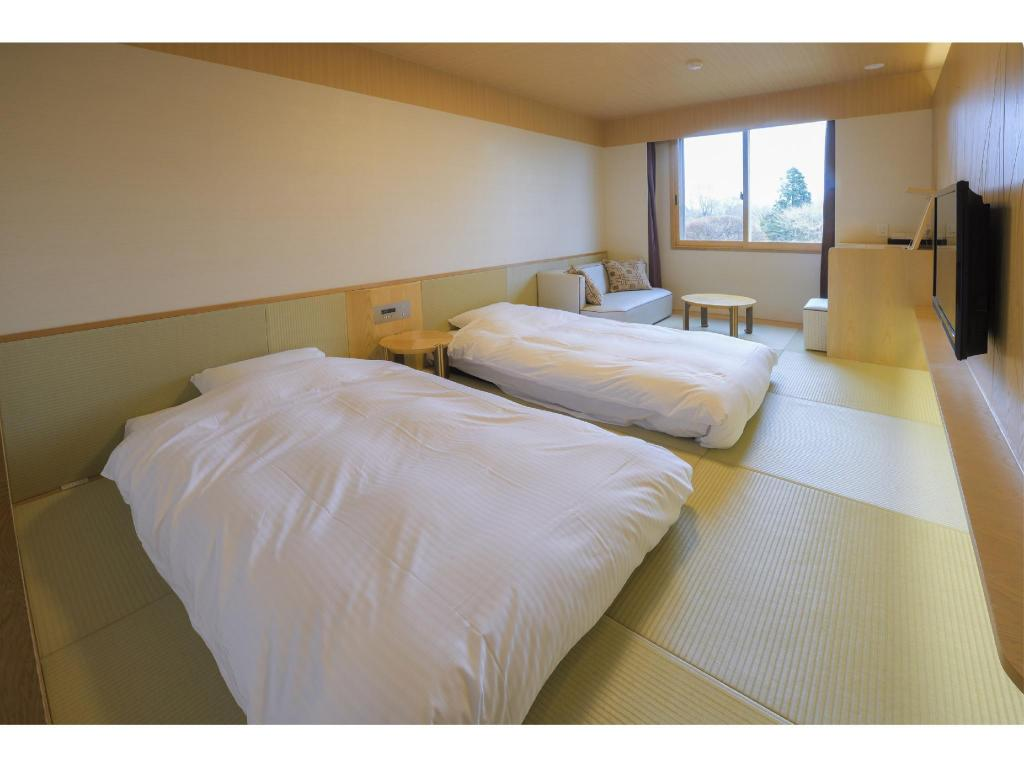 Japanese-style Room (Twin Beds) *No toilet in room - ห้องพัก