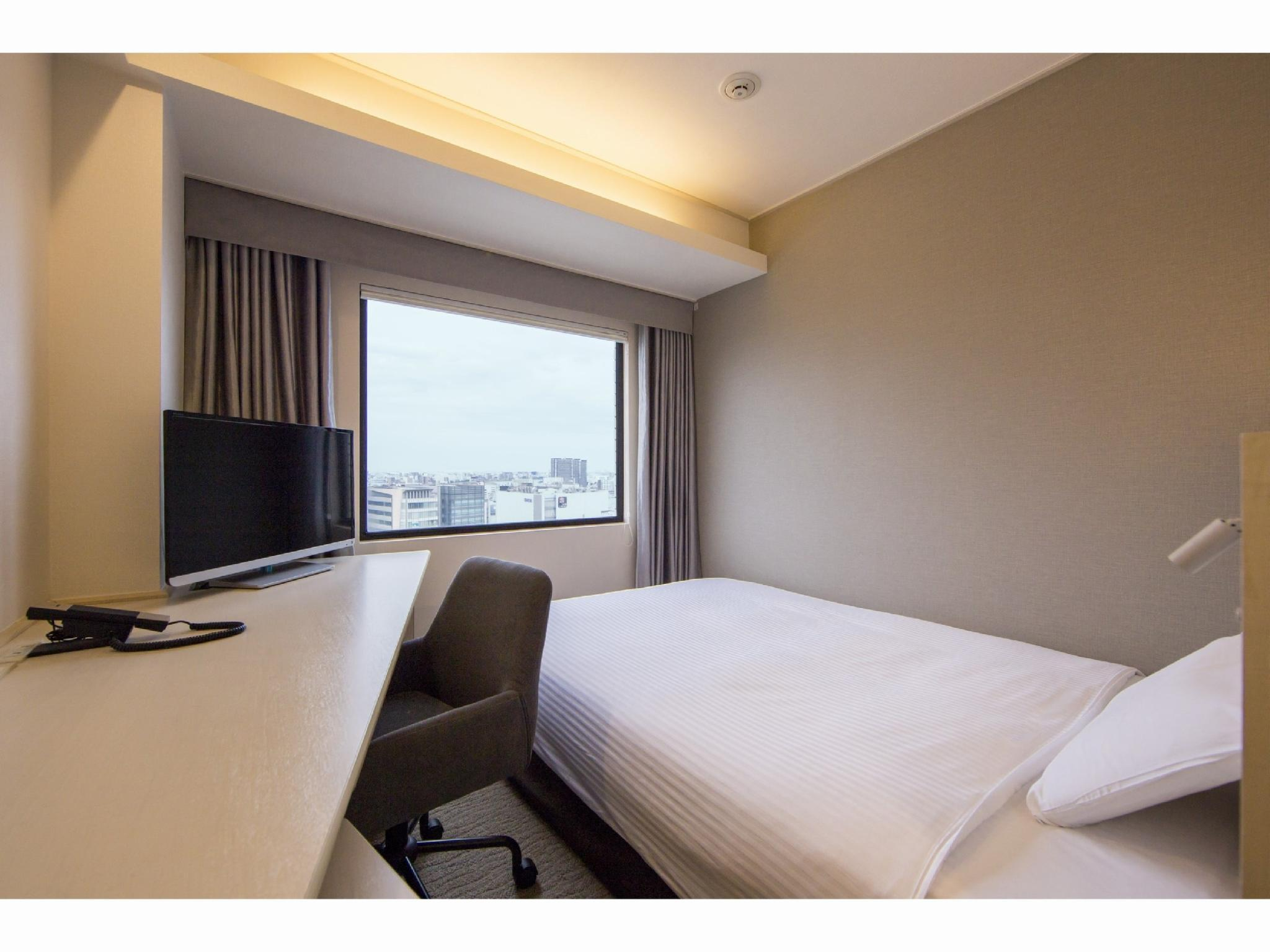 舒适双人中床房 (Comfort Semi-double Room)