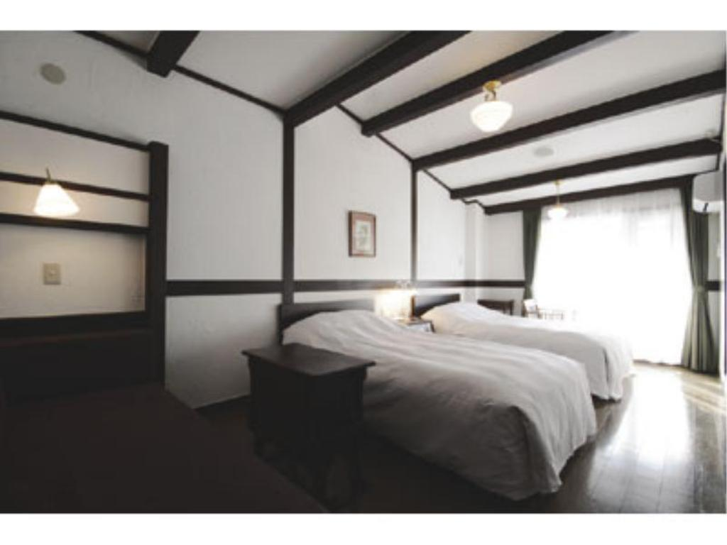 Moderate Twin Room (Main Building) - Guestroom Hotel Jogakura