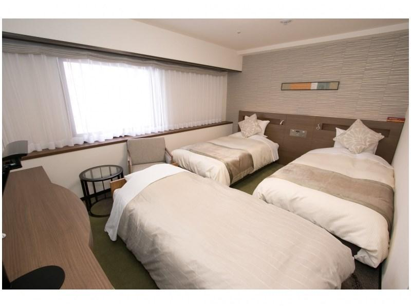 Triple Room (Twin Room + Extra Bed)