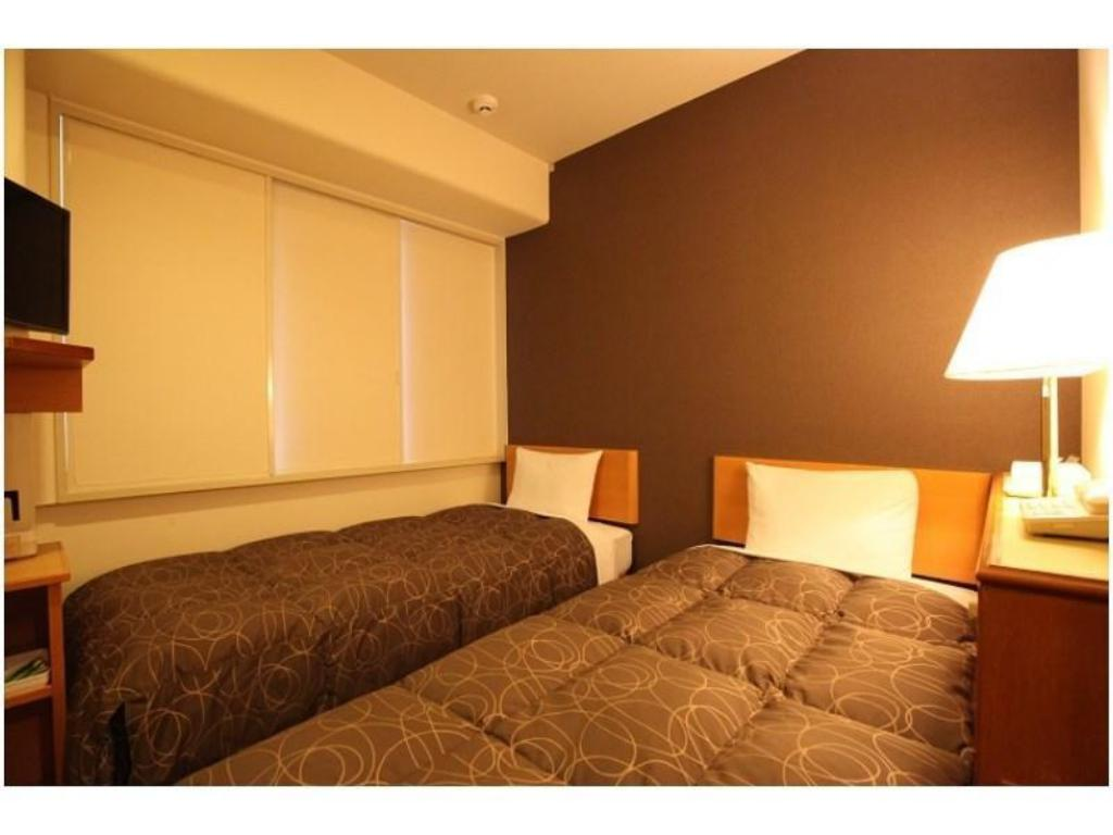 Economy Twin Room *Slightly narrow - ห้องพัก