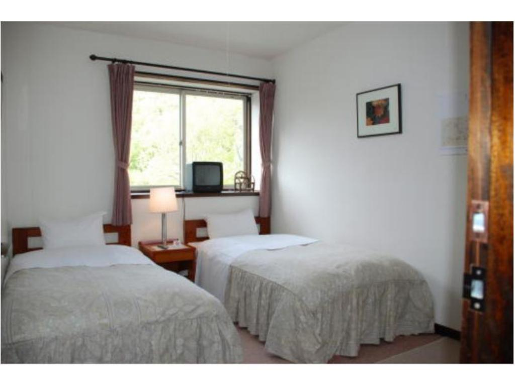 Twin Room *No bath or toilet in room or Has bath and toilet - Guestroom Pension Endless
