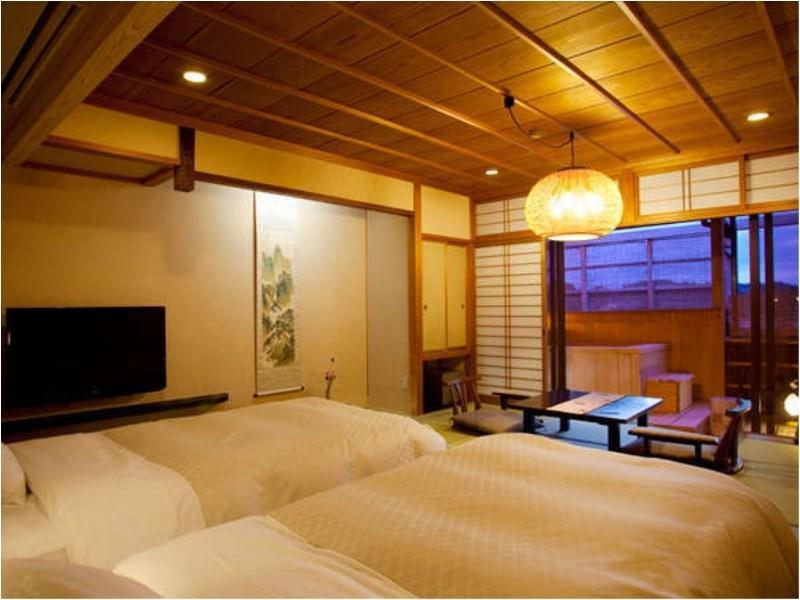 Japanese Style Twin Bed Room with Private Open Air Onsen on the Balcony.