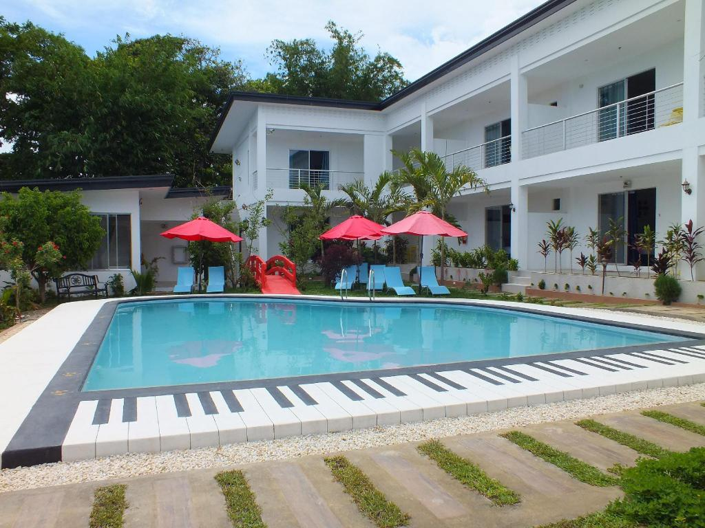 Paboreal boutique hotel in palawan room deals photos - Hotel in puerto princesa with swimming pool ...