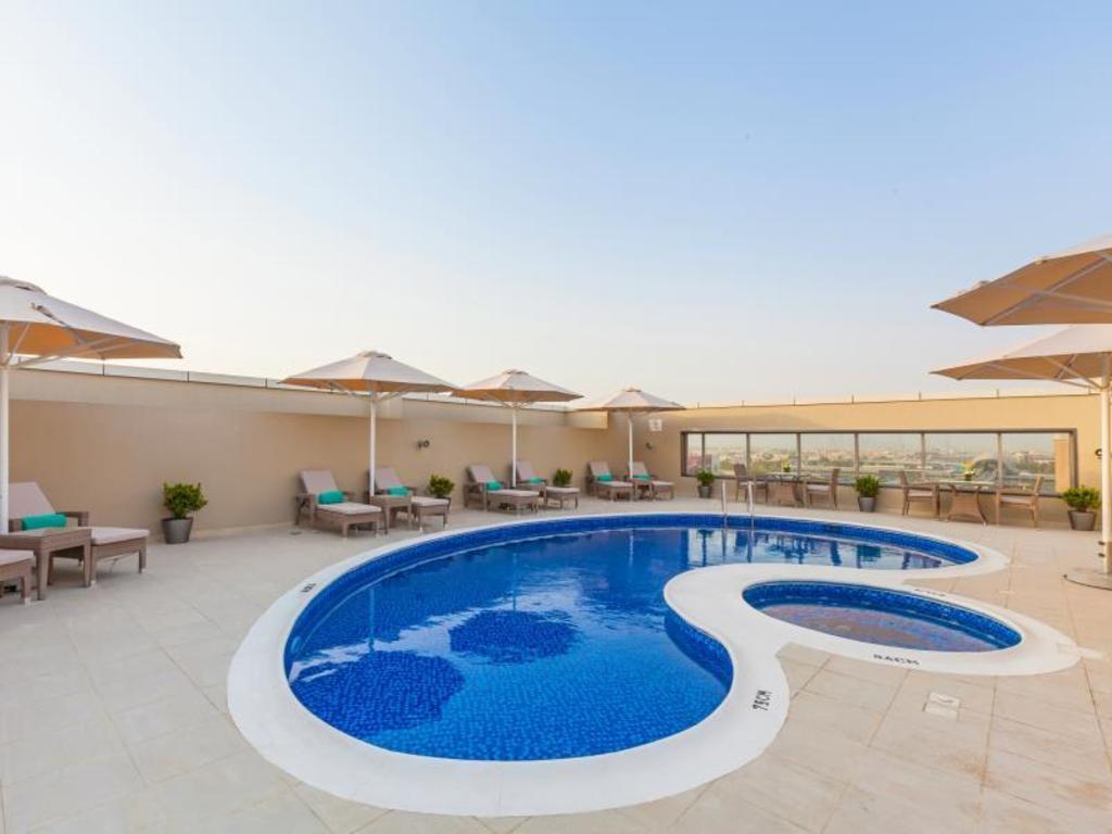 Best price on hotel flora al barsha in dubai united arab emirates for Dubai airport swimming pool price