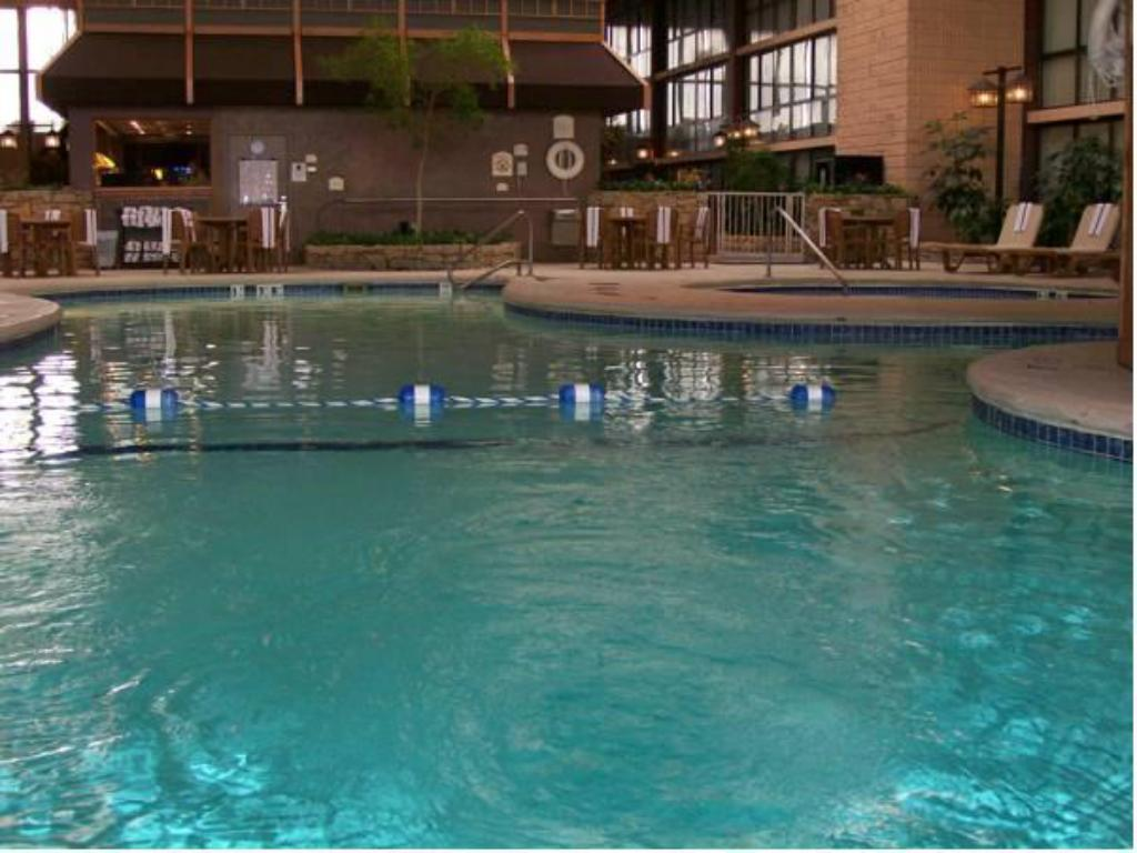 Swimming pool [outdoor] SureStay Plus Hotel by Best Western Kansas City Northeast