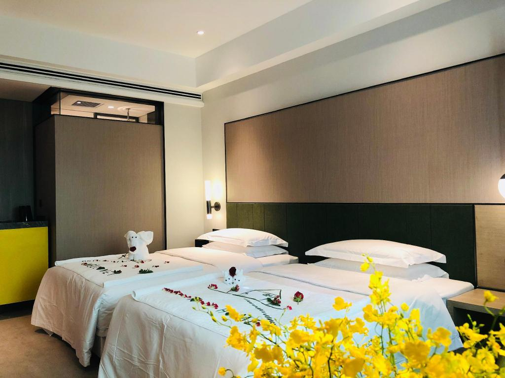 Standard Twin Bed in North Building - Guestroom Empark Grand Hotel