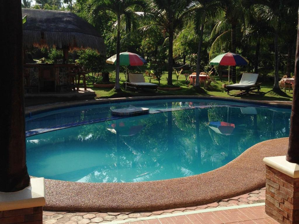 Best price on dumaguete springs beach resort in dumaguete - Hotels in dumaguete with swimming pool ...