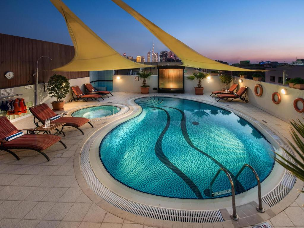 Swimming pool [outdoor] Savoy Suites Hotel Apartments