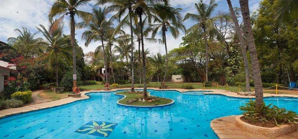 Holiday village in bangalore room deals photos reviews Bangalore resorts with swimming pool