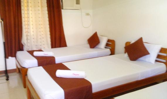 Triple Sharing Room with Breakfast and Roundtrip Airport Transfer**