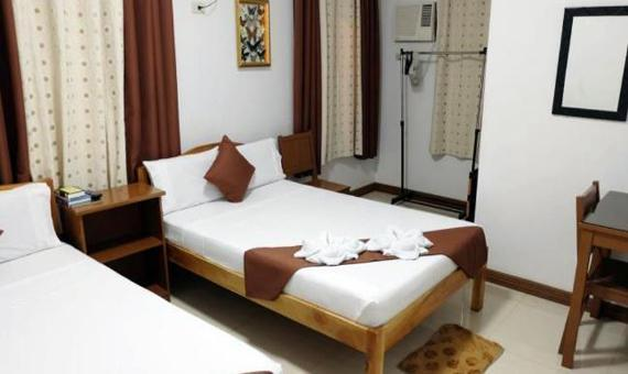 Quad Sharing Room with Breakfast and Roundtrip Airport Transfer**