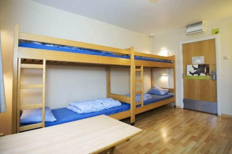 Bed in dormitory MALE WITH 6 SHARED SINGLE BEDS WITH SHARED BATHROOM