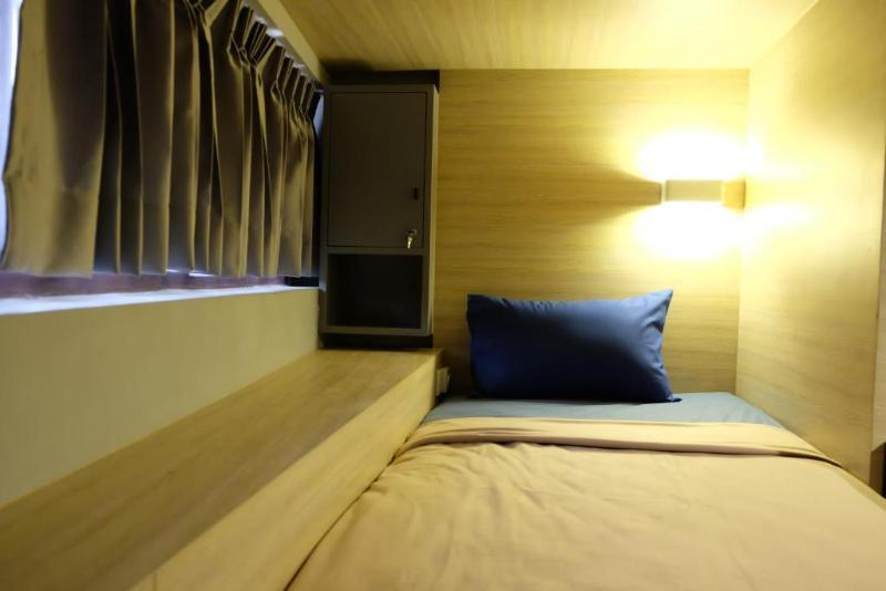 Bed in dormitory 4 Beds Private Room With Shared Shower and Bathroom